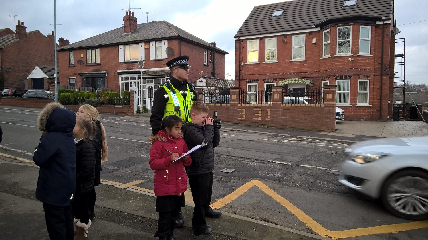 Children on Kimberworh Road using the speed gun