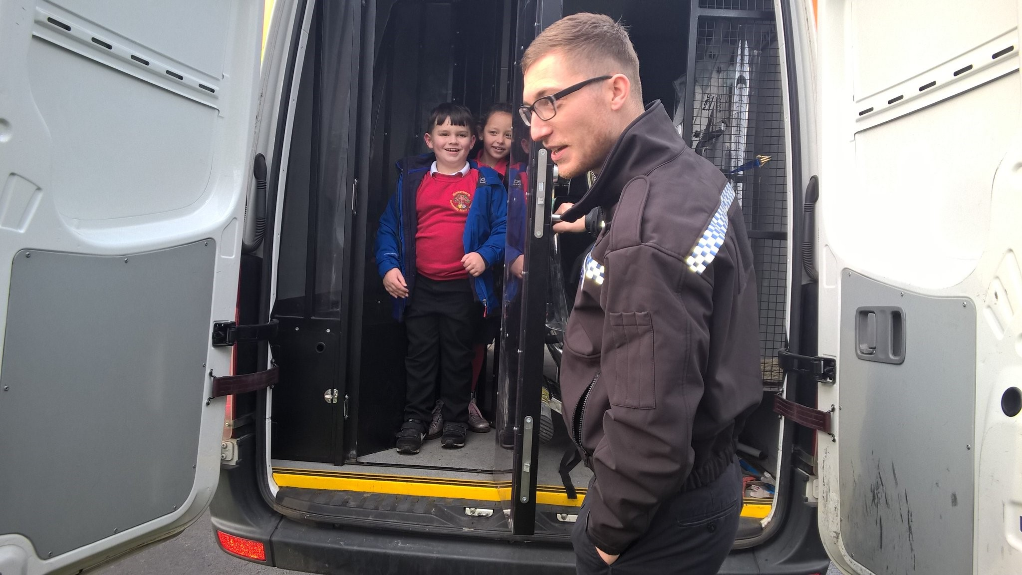 P.C Matt Baker showing children the back of a police van